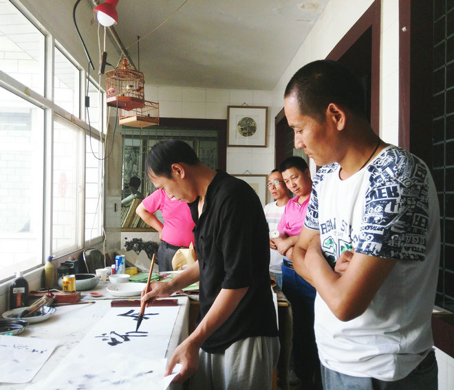蔡兴洲、张寿庠书画交流笔会在定西三义书画社举行